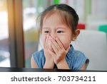 cute little asian girl hold the ... | Shutterstock . vector #703734211
