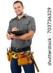 carpenter with clipboard | Shutterstock . vector #703736329