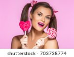 gitl with two ponytails | Shutterstock . vector #703738774