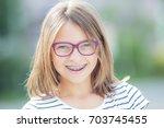 happy smiling teen girl with... | Shutterstock . vector #703745455
