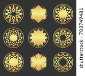 set of gold floral ornament.... | Shutterstock .eps vector #703749481