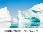 big icebergs floating in the... | Shutterstock . vector #703767271