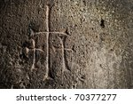 Three Crosses Carved Into The...