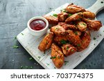 baked chicken wings with sesame ... | Shutterstock . vector #703774375