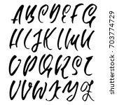 hand drawn dry brush font.... | Shutterstock .eps vector #703774729
