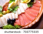 fish plate with salmon and... | Shutterstock . vector #703775335