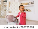 happy mixed race toddler boy | Shutterstock . vector #703775734