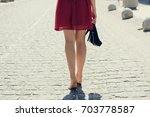 young pretty woman in red dress ... | Shutterstock . vector #703778587