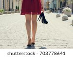 woman in red dress  with high... | Shutterstock . vector #703778641