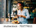 young african woman smiling... | Shutterstock . vector #703779811