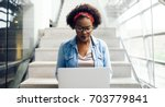 focused young african female... | Shutterstock . vector #703779841