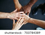closeup of a diverse group of... | Shutterstock . vector #703784389