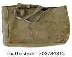 an old tarpaulin canvas bag for ... | Shutterstock . vector #703784815