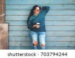 beautiful woman wearing fall... | Shutterstock . vector #703794244