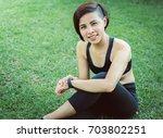 portrait sport asian woman... | Shutterstock . vector #703802251