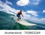 muscular surfer with long white ... | Shutterstock . vector #703802269