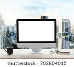 desktop computer white frame on ... | Shutterstock . vector #703804015