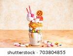 extreme milkshake. overshake.... | Shutterstock . vector #703804855