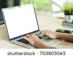 hand typing laptop computer... | Shutterstock . vector #703805065