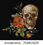 embroidery skull and roses. dia ... | Shutterstock .eps vector #703811029