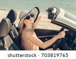 young woman drive a car on the... | Shutterstock . vector #703819765