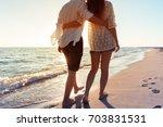 summer couple at beach | Shutterstock . vector #703831531