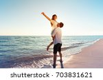 young couple loving vacation | Shutterstock . vector #703831621