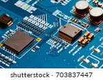 electronic circuit board close... | Shutterstock . vector #703837447