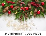 christmas fir branch decorated... | Shutterstock . vector #703844191