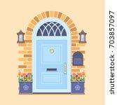 blue front door on the yellow...   Shutterstock .eps vector #703857097