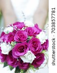 bride holding a purple and... | Shutterstock . vector #703857781