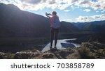 young brunette woman hiker...   Shutterstock . vector #703858789