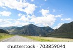 amazing landscape of a road in... | Shutterstock . vector #703859041