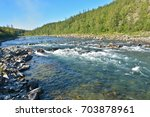 the rapids on a northern river. ... | Shutterstock . vector #703878961
