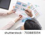 businessman and businesswoman... | Shutterstock . vector #703885054