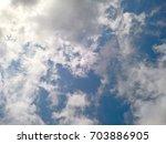 cloudy summer sky | Shutterstock . vector #703886905