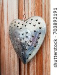 Small photo of Stylized ironwork in and a heart shape to use as deco for a wedding or adornment for a garden background