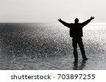 Man Spreading His Arms Toward...