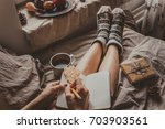 cozy home. woman with cup of... | Shutterstock . vector #703903561