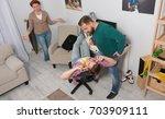 teenage boy closing ears while... | Shutterstock . vector #703909111