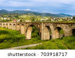 old railway bridge  old viaduct ...   Shutterstock . vector #703918717