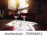 red wine in glasses  wine...   Shutterstock . vector #703926811