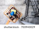 aerial of a worker with blue... | Shutterstock . vector #703943029