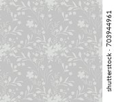 seamless monochrome floral...   Shutterstock .eps vector #703944961