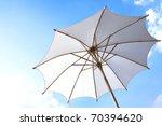 white umbrella over the blue sky | Shutterstock . vector #70394620