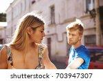 quarrel between young lovers... | Shutterstock . vector #703947307