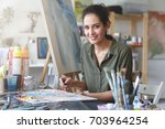 portrait of young talented... | Shutterstock . vector #703964254