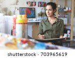 portrait of young female of... | Shutterstock . vector #703965619