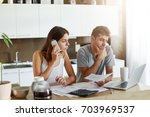 business couple working on...   Shutterstock . vector #703969537