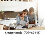 family couple having many bills ... | Shutterstock . vector #703969645